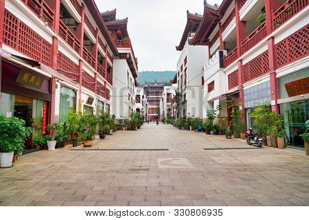 SHENZHEN, CHINA - CIRCA APRIL, 2019: view of a pedestrian street located at Wenbo Palace in the daytime. Wenbo Palace is a large architectural complex in ancient style in Shenzhen.