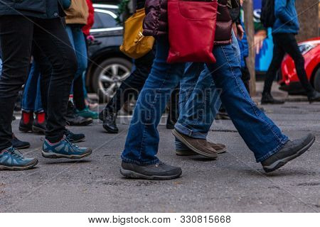 Many Legs Are Viewed Marching In A Town Center As Environmentalists Demonstrate Together, Bustling S