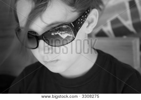 B&W Portrait Of Young Girl Wearing Black Sunglasses