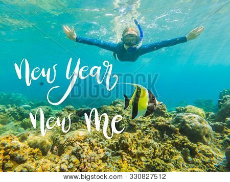 New Year New Me Concept Happy Woman In Snorkeling Mask Dive Underwater With Tropical Fishes In Coral