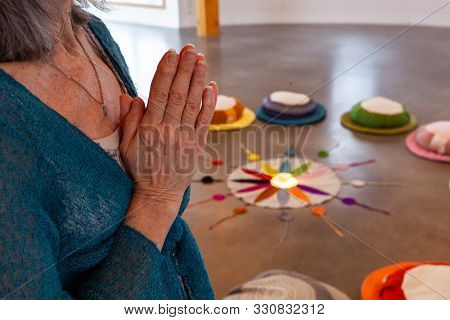 Hands Of A Religious Person Are Seen Closeup, Held Together As She Prays In A Peaceful Room, Twelve