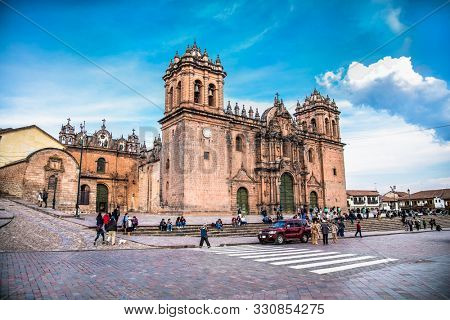 Cusco, Peru - Jan 6, 2019: Historic Colonial Buildings on the Plaza de Armas Square with Many Visitor at Night, Cusco, Peru, South America,