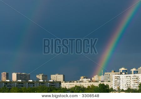 Raibow Over City