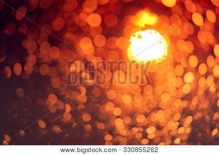 Orange Night Light Bokeh Background. City Life. Blur Abstract Background Of Urban Light. Warm Light