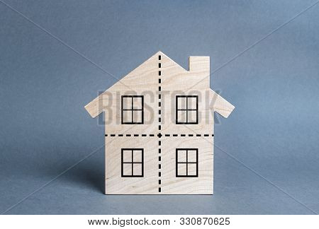 Residential Building Divided By A Dotted Line Into Four Equal Parts. Divorce Concept. Disputes Over