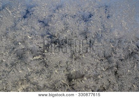 Frosty Pattern On The Glass. Frosted Glass Ice Background, Natural Beautiful Snowflakes.blue Frost B