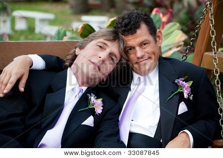 Portrait of very handsome gay male couple on their wedding day.