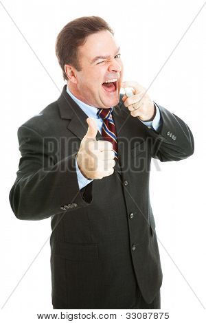 Businessman using mint breath spray and giving thumbs up sign.  Isolated on white.