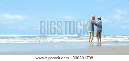Asian Lifestyle Senior Couple Dancing On The Beach Happy And Relax Time.  Tourism Elderly Family Tra