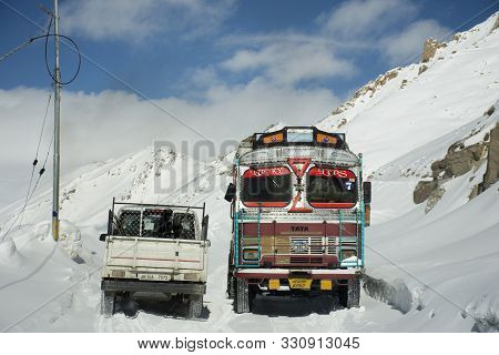 Indian And Tibetan Drive Car And Colorful Truck On Khardung La Road In Himalaya Mountain Go To Nubra