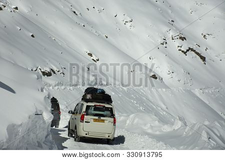 Indian People Driving Van On Khardung La Road Pass Go To Nubra Valley In Hundar City While Winter Se