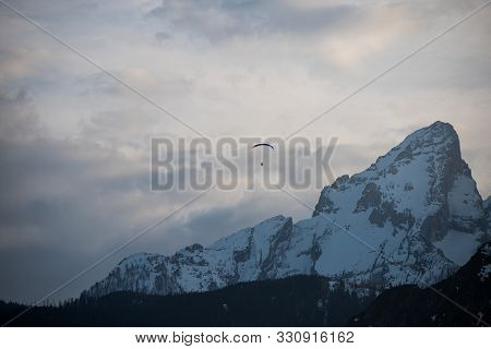 Amazing Scenery Of A Parasaglider, High At The Mountaintops At Berchtesgaden Germany