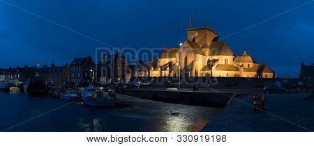 Barfleur, Manche / France - 16 August, 2016: The Saint Nicolas Church And Harbor In Barfleur Nightti