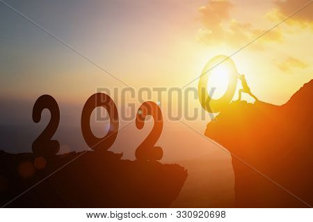 2020 New Year , Young Businessman Pushing 2020 Happy New Year Towards Goals And Jump Cliff Across Be