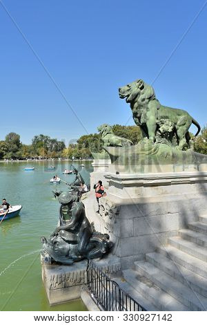 Lion In The Monument A Alfonso Xii In The Garden Of The Retiro Park In Madrid. Spain. Europe. Septem