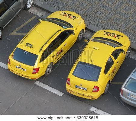 Prague, Czech Republic - Circa December 2017: Yellow Taxi Cabs Parked In The City Centre