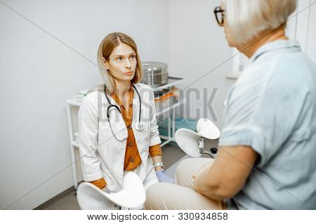 Gynecologist Listening To A Senior Woman Patient During A Medical Consultation In Gynecological Offi