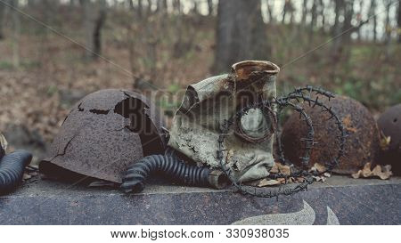 The Old Rusty Military Paraphernalia Are On The Memorial In The Park.