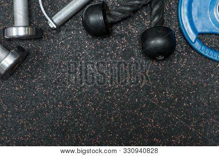 Cross Fit Equipment On Floor In Gym.