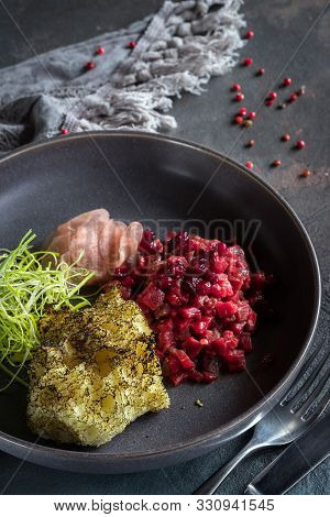 Beef Tar-tar With Dried Cranberries And Daikon On Gray Background. Spoon, Fork And Gray Tablecloth