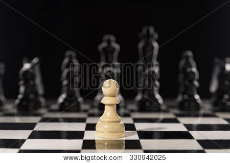 Single Pawn Against Many Enemies As A Symbol Of Difficult Unequal Fight Or Struggle Of Minorities