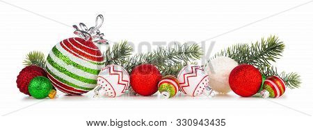 Christmas Border Of Red, Green And White Ornaments With Branches. Side View Isolated On A White Back