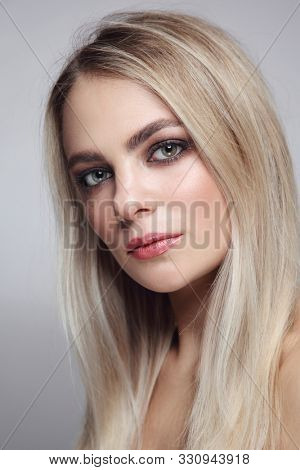 Portrait of young beautiful blonde girl with smoky eye makeup