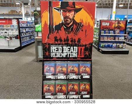 Honolulu -  October 30, 2018:  Red Dead Redemption 2 Video Game Display For Xbox One And Ps4 Inside