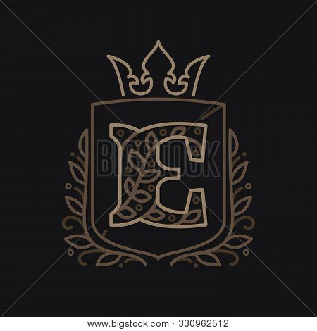 E Letter Logo Consisting Of Floral Pattern Letters In A Heraldic Shield With Crown. Can Be Used For
