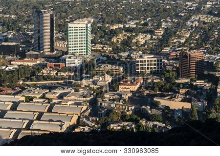 Burbank, California, USA - October 20, 2019:  Morning view of Warner Bros studio and Burbank Media District office buildings and homes in the San Fernando Valley area of Los Angeles County.