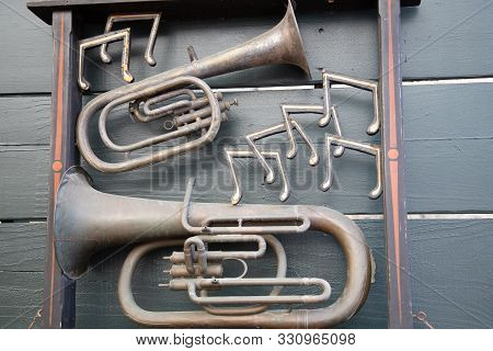 Cornet Jazz Instruments With Musical Notes On Wall Hanging