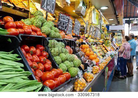 Malaga, Spain - May 24, 2019: People At Fruit And Vegetable Stalls Inside The Famous Atarazanas Mark