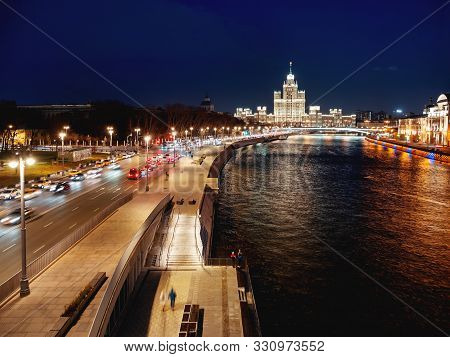 Night cityscape of Moscow-river and famous Stalins skyscraper on Kotelnicheskaya embankment. Moscow, Russia. poster
