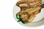 Fried freshwater fish with in ceramic plate on white background poster