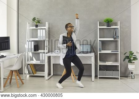 Funny Happy Excited Young Black Business Woman Dancing And Having Fun In The Office