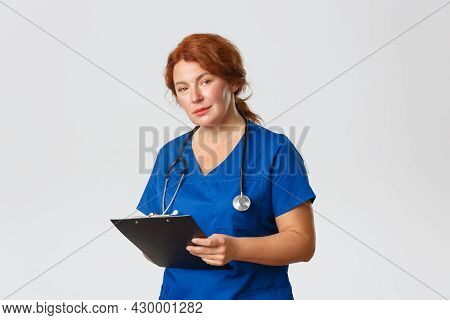 Medicine, Healthcare And Coronavirus Concept. Friendly-looking Cute Female Doctor, Physician In Scru