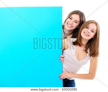 happy teen girls holding big blue empty banner over white