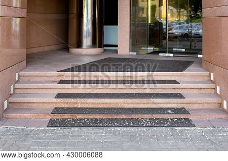 Threshold With Step With Foot Mat At Entrance To Store With Tempered Glass Door In Doorway Tiled Wit
