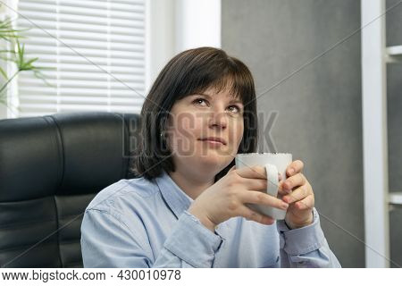 Portrait Of Pensive Woman With Cup Of Coffee In Her Hands. Beautiful Brunette Girl. Lunch Break. Cof