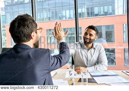 Two Happy Smiling Diverse Professional Businessmen Executive Leaders Giving Highfive After Successfu
