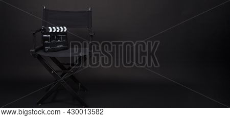 Black Director Chair And Clapperboard Or Movie Slate .it Use In Video Production Or Movie And Cinema