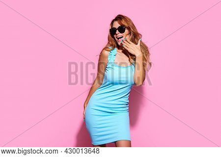 Laughing Girl In Stylish Pink Sunglasses Looks At Something Surprisingly Through Her Sunglasses Cove