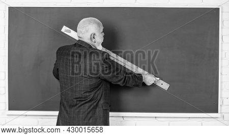 Senior Man Teacher Use Ruler While Drawing. Bearded Tutor Man Draw With Ruler On Blackboard. Back To