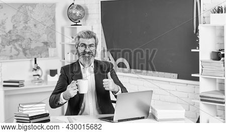 Good Drink For Good Work. Bearded Man With Cup Give Thumb Up. Senior Teacher Drink Coffee In Class.