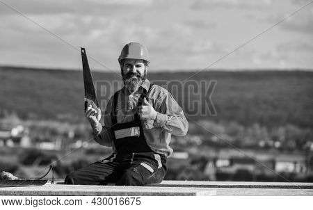 Construction Carpentry. Man Builder Wear Uniform And Hard Hat For Protection. Carpentry Concept. Har