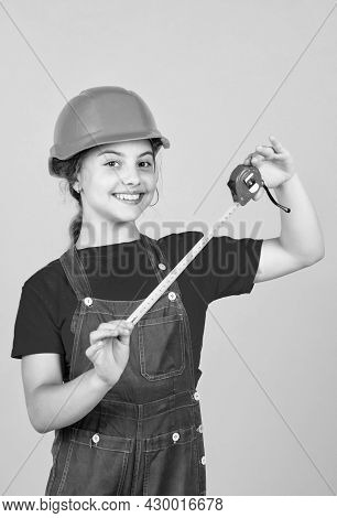 Length. Construction Worker With Tape Measure. Cute Kid As A Construction Worker. Kid Repairing Home