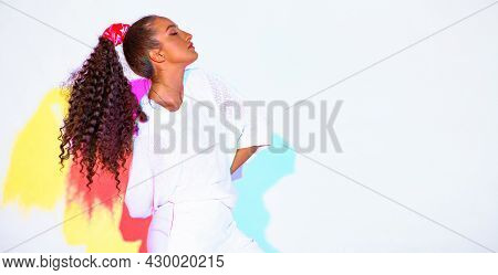 Beautiful Mixed Race Young Modern Girl In Colourful Rainbow Studio Light On White Background, Copy S
