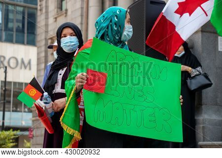 Vancouver, Canada - August 14,2021: Woman Is Holding A Sign Afghan Lives Matter, Stop Terrorism Outs