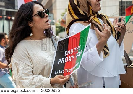 Vancouver, Canada - August 14,2021: Woman Is Holding A Sign End The Proxy War Outside Of Vancouver A
