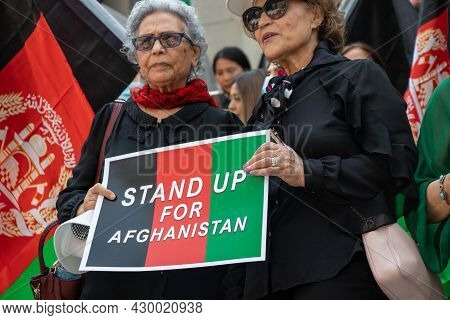 Vancouver, Canada - August 14,2021: Women Are Holding A Sign Stand Up For Afghanistan Outside Of Van
